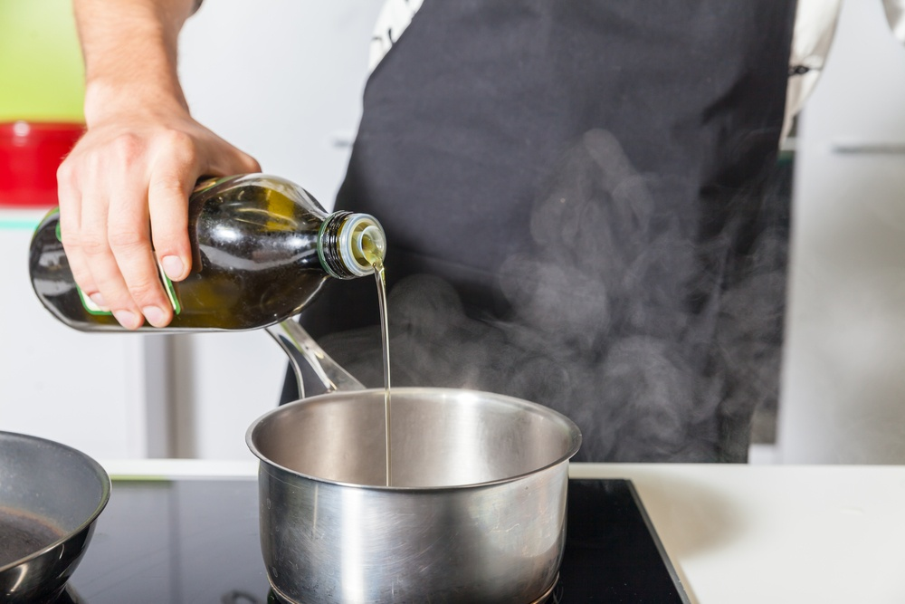 ChefPouringOliveOil.jpg